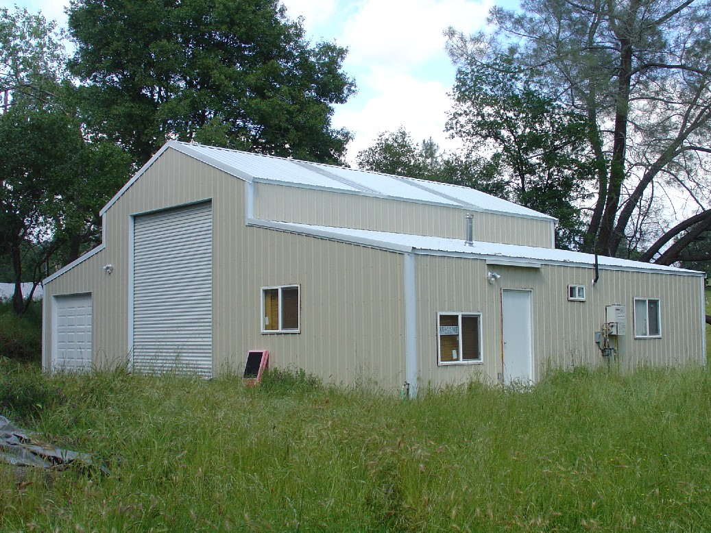 Gold coast steel buildings photo gallery for Metal barns with living quarters plans